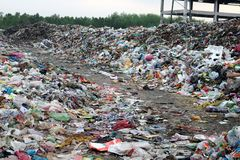 Huge heaps of multiple type of garbage lying in garbage dumping site royalty free stock photography
