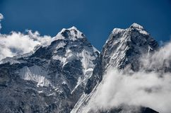 Huge Himalayan mountain  amadablam with a glaciers in Nepal royalty free stock photos