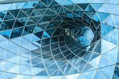 Huge hole in a contemporary building in Frankfurt. Royalty Free Stock Image