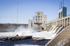 Huge hydro water dam with gushing water over the turbines. Royalty Free Stock Photo