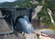 Huge hydroelectric power dam of Kurobe in Japan. Hydroelectric power dam of Kurobe in Japan, It creates a rainbow and everyday a lot of people visit this Royalty Free Stock Photography
