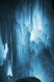 Huge ice icicles. Large blocks of ice frozen waterfall or water. Blue ice background. Frozen stream waterfall Royalty Free Stock Image