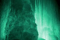 Huge ice icicles. Large blocks of ice frozen waterfall or water. Light green ice background. Frozen stream waterfal Stock Photography
