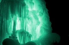 Huge ice icicles. Large blocks of ice frozen waterfall or water. Light green ice background. Frozen stream waterfal Royalty Free Stock Photo