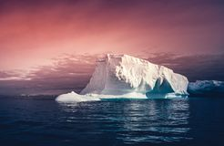 The huge iceberg on the colorful sky background. royalty free stock photos