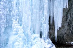 Icefall on a rock wall. Huge icefall on a rock wall royalty free stock photo