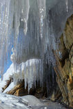 Huge icicles on a cliff. Stock Images