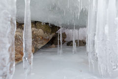 Huge icicles on a cliff. Stock Image