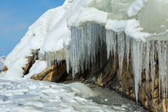 Huge icicles on a cliff. Stock Photography