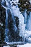 Huge icicles formed in a waterfall Royalty Free Stock Image