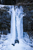 Huge icicles formed in a waterfall Stock Photography