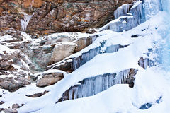 Huge icicles on a mountain Royalty Free Stock Photo