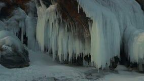 Huge icicles on rocks. stock video footage