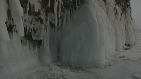 Huge icicles on rocks. stock video