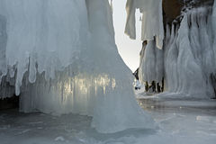 Huge icicles on rocks. Stock Photo