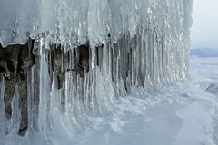 Huge icicles on rocks. Stock Image