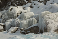 Huge icicles on rocks. Royalty Free Stock Photos
