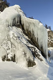 Huge icicles on rocks. Royalty Free Stock Photo