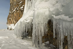 Huge icicles on rocks. Stock Photos