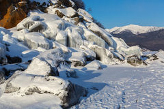 Huge icicles on rocks. Royalty Free Stock Image