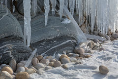 Huge icicles on rocks. Beautiful winter landscape in Lake Baikal. Royalty Free Stock Images
