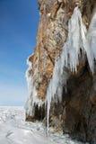 Huge icicles on rocks. Beautiful winter landscape in Lake Baikal. Royalty Free Stock Image