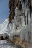 Huge icicles on rocks. Beautiful winter landscape in Lake Baikal. Stock Photo