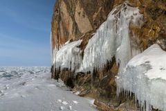 Huge icicles on rocks. Beautiful winter landscape in Lake Baikal. Royalty Free Stock Photography