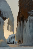 Huge icicles on rocks at sunrise. Stock Images