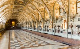 Statues, Portraits and Paintings in a large hall. Huge indoor room with many portraits, statues and paintings al over royalty free stock photos