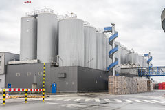 Huge, industrial containers with beer. And palettes Royalty Free Stock Photos