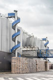 Huge, industrial containers with beer. And palettes Stock Photography