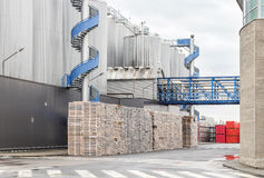 Huge, industrial containers with beer. And palettes stock photos