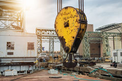Huge industrial crane hook in the port for container cargo lifting. Royalty Free Stock Image