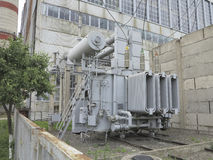Huge industrial high-voltage substation power transformer on rai Stock Photo