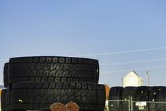 Huge industrial tires stacked on top of each other stock image