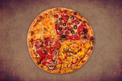Huge international pizza on red background. Delivery 24 hours. Concept Stock Photos