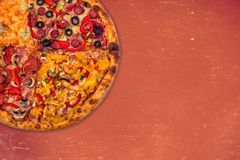 Huge international pizza on red background. Delivery 24 hours. Concept Royalty Free Stock Image