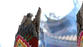 Huge joss stick. Huge joss stick,focus pulled Chinese house background