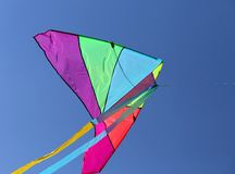 Huge kite flies high in the sky blue Stock Images