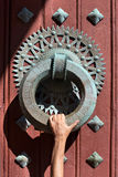 Huge knocker with a hand that grabs Royalty Free Stock Images