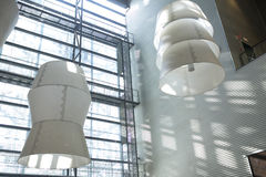 Huge lamps in a modern building interior Stock Image