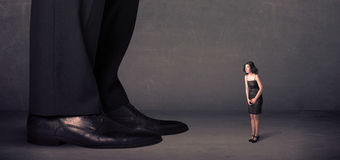 Huge legs with small businesswoman standing in front concept Royalty Free Stock Photos