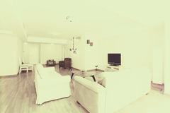 Huge livingroom. Modern living room with new couches and TV royalty free stock photo