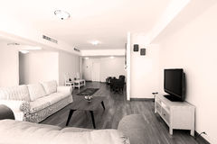 Huge livingroom. Modern living room with new couches and TV stock images