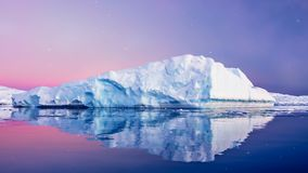 Huge long iceberg with mirror reflection in water stock video footage