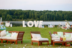 Huge LOVE letters as a fancy wedding decoration. On a river bank Royalty Free Stock Images