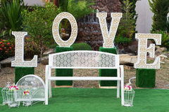 Huge LOVE letters. As a fancy wedding decoration on a river bank stock image