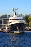 Huge luxury motor yacht moored beside a wharf / jetty royalty free stock photos