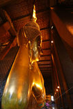 Huge Lyinig Buddha in Wat Pho Temple in Bangkok, ThailandIt is 15m high and 45m long. Stock Photo